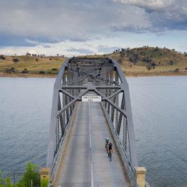 Cycling across Bellbridge bridge over the Murray River