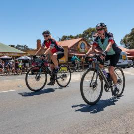 Road cyclists riding through the Glenrowan township