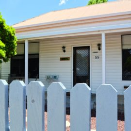 Front of Walwa Cottage showing front door and windows and the beautiful white picket fence