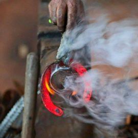 Blacksmith Brendan making a horseshoe